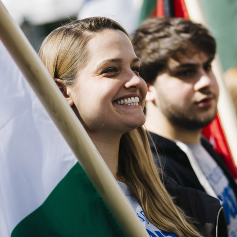 Students hold flags at Celebration of Nations.