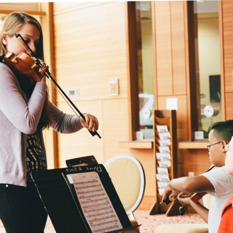 Music lessons at the Nat King Cole Generation Hope, Inc. Summer Strings camp at 365体育网站