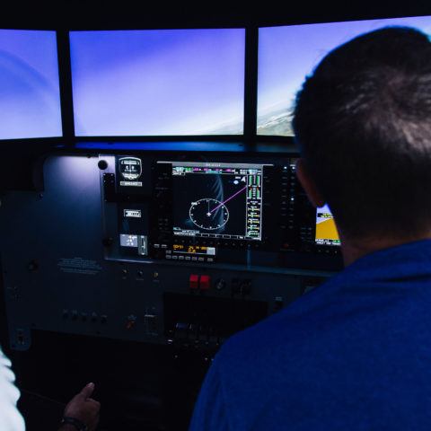 Two students learn in the flight simulator